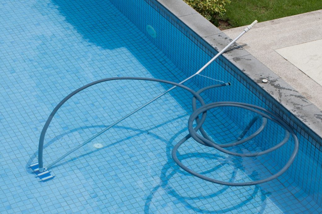 Pool with the underwater vacuum cleaner. sports concept